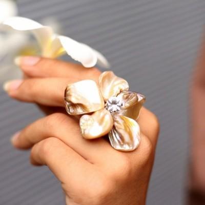 white-flower-stone-ring